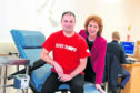 Survivor Rod Mair, with head of service Dr Sylvia Armstrong-Fisher,  is backing the major campaign to attract 50 blood donors a day to keep blood stocks up