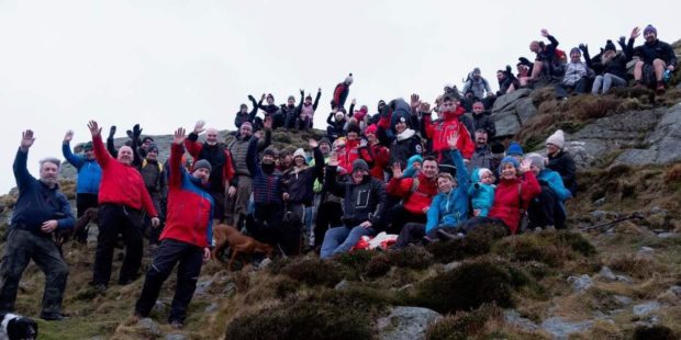Around 80 people climbed Bennachie in aid of two terminally ill people.