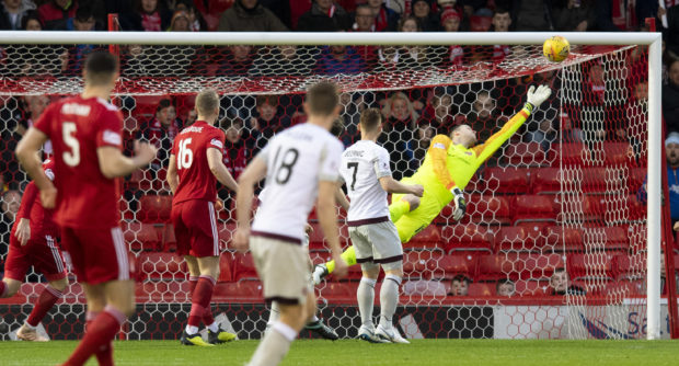 Aberdeen striker Sam Cosgrove scores past Hearts goalkeeper Colin Doyle to make it 1-0.