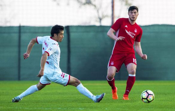 Aberdeen's Scott McKenna  in action in last year's friendly against Lokomotiv Tashkent..