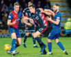Inverness CT's Sean Welsh (right) battles with Ross County's Ross Stewart.