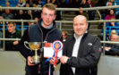 William Moir collects the overall champion trophy from show sponsor Eric Thomson.