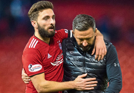 Aberdeen captain Graeme Shinnie celebrates with manager Derek McInnes at full time.