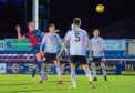 Inverness CT's Jordan White (L) heads in Inverness' goal against Ayr