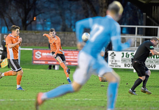 Referee Alan Proctor ducks as Alisdair Sutherland of Rothes scores his teams opening goal from well outside the box.