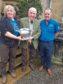 NFU Scotland Argyll and the Islands Stalwart Award winner Sandy McKirdy (Centre) receiving the award from John Dickson and Sybil MacPherson