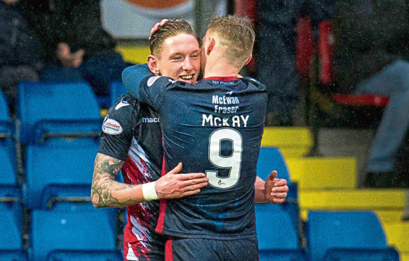 Declan McManus has extended his stay at Ross County.