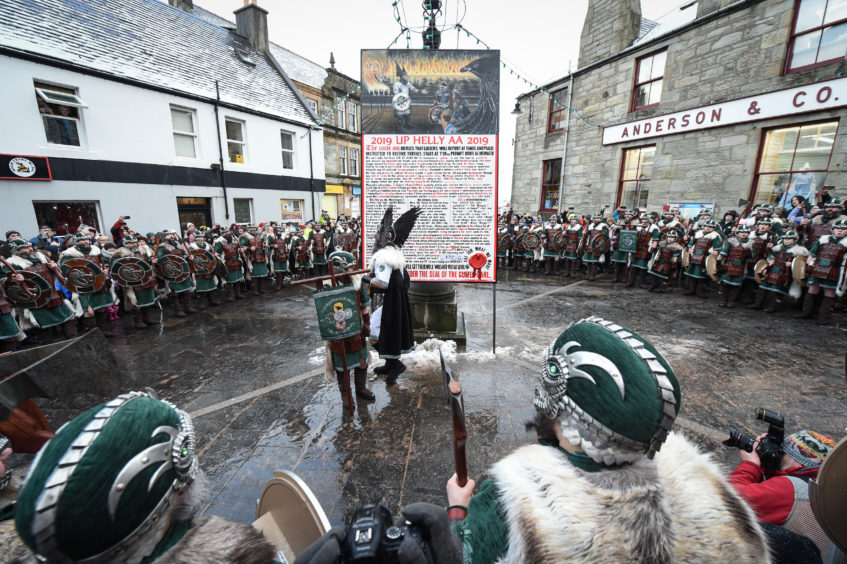 An image captured during the rendition of the Up Helly Aa song at Market Cross.