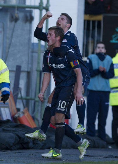 Ross County captain Richard Brittain celebrates his part in his side's third goal with team-mate Iain Vigurs (top).
