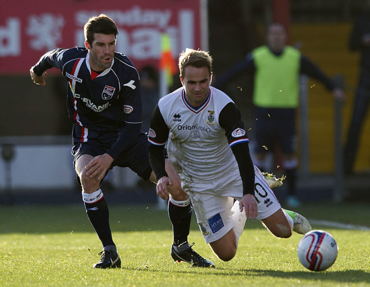 ICT's Andrew Shinnie loses his footing under pressure from Rocco Quinn (left)