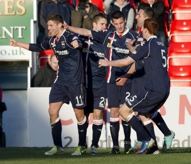 Ross County's Iain Vigurs (left) celebrates his deflection-aided equaliser with his team-mates.