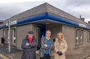 Moray MSP Richard Lochhead with Lossiemouth Community Council chairman Mike Mulholland and vice-chairwoman Carolle Ralph outside the Bank of Scotland in Lossiemouth
