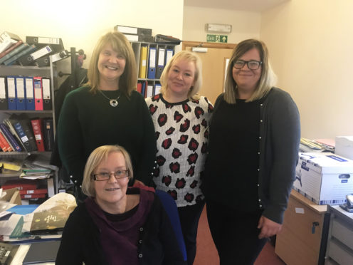 Jennifer Harvey, Wick development worker, Julie Marker, rural development worker, and Joan Lawrie, Thurso development worker, with part-time co-ordinator Yvonne Hendry at the front.