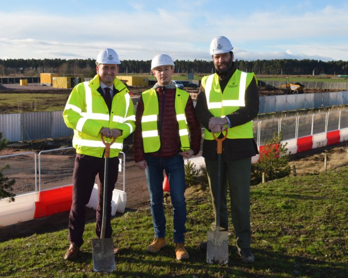 General manager of Inverness Airport Graeme Bell, Polcom Construction Site manager Adam Weyna, and director of Inverness Airport Business Park Andrew Howard at the site as construction gets underway