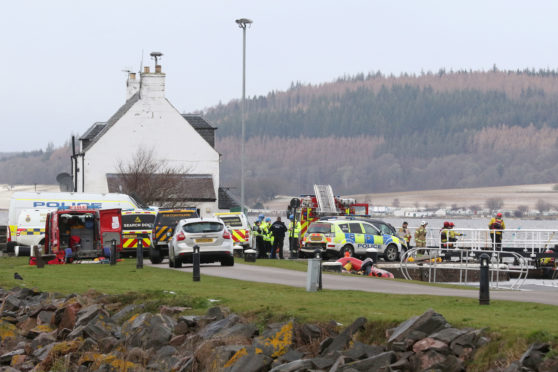 Police, fire and coastguard personnel during the major search operation near to Clachnaharry locks yesterday.