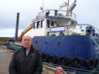 Marc Macrae beside the Moray Council dredger