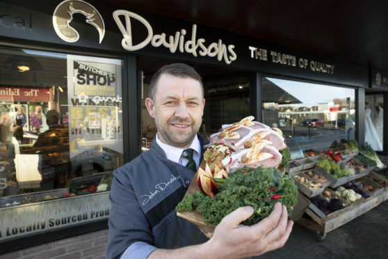 John Davidson pictured with his Pork Chops stuffed with Parsley, Red Chilli & Apple Butter Picture by Graeme Hart.
