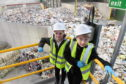 Jayden McGreggor and Hubert Dygas from Tullos Primary School attended the opening of the visitor education experience at SUEZ's new Altens site.