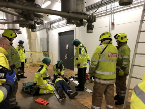 Emergency crews working on a major head injury scenario presented at the training day at the Mowi Fish Feed Plant in Kyleakin