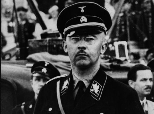 Heinrich Himmler chief of the SS and the Gestapo dressed in SS uniform.