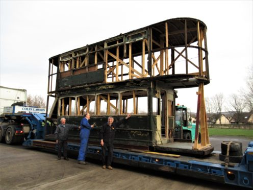 Joe Mackie, Gordon Mills and Ian Souter of the Aberdeen and District Transport Preservation Trust having inspected Aberdeen tram 15 on low-loader following its arrival on site at Alford.