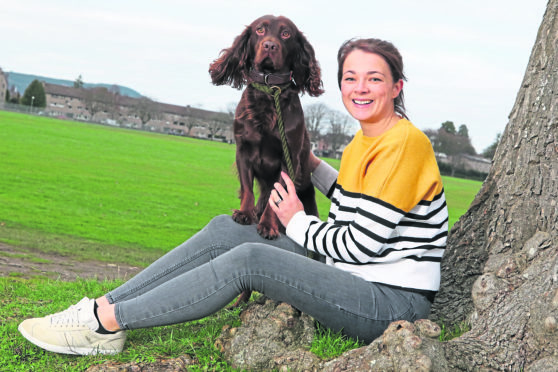 Fitness: Dr Anne Rennie, herself a keen long-distance runner, with her three-year-old cocker spaniel Winston at Bught Park in Inverness.