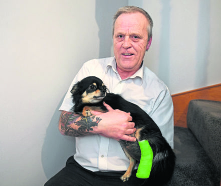 Bruce Watkins and Dodie. the dog that got attacked along with it's owner Picture by Chris Sumner.