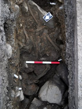 Bones, believed to date back to the 16th century, discovered as the Scottish Water project was being undertaken in the Highland village of Kingussie.