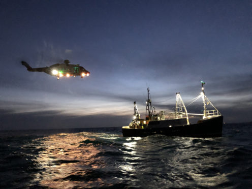 The coastguard helicopter with the fishing boat.