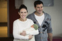 New Zealand Prime Minister Jacinda Ardern, left, with her partner Clarke Gayford, holds their newly born baby girl, Neve, at Auckland Hospital on Sunday, June 24, 2018. Ardern made her first public appearance on Sunday since giving birth to her daughter on Thursday. (Greg Bowker/New Zealand Herald via AP)