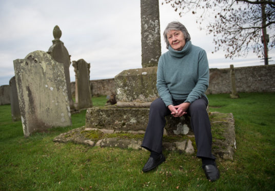 Iona Kielhorn of Lossiemouth Heritage Association at Kinneddar graveyard. Picture by Jason Hedges