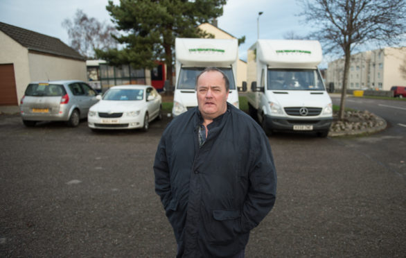 Raymond Bissett in the parking area of St. Andrews Square in Elgin, Moray.