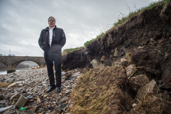 Councillor John Cox is pictured at Banff bridge.