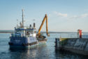 The Buckie Dredger (Selkie), dredging in Burghead, Moray.