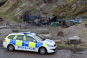 Police Scotland at the scene of a fire at Cove Harbour.