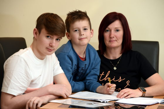 achael Smith with her children who suffer from dyslexia (L-R) Brook, 15, and Archie, 8