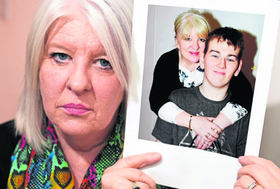 Tracey Gibbon with a picture of her son Kyle who has ADHD has been stuck in Carstairs with no criminal record or sign of release.