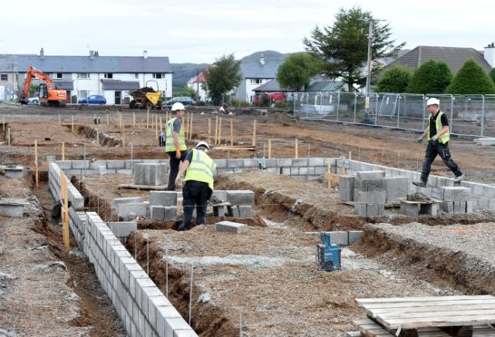 Workers in August on the new development at the Birches area in Kyleakin near to where the overhead cables were portraying sparks last night. Picture by Sandy McCook