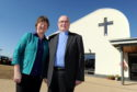 Rev Ian Ferguson with his wife Heather outside Westhill Community Church.