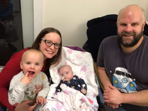 Ruth Stormont with son Ben, baby Carys and partner Gareth Vaughan, who has raised over £4,550 for The Archie Foundation from a fundraising bake sale