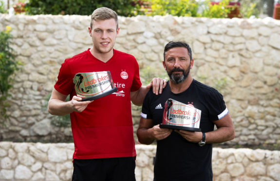 Sam Cosgrove and Derek McInnes received their monthly awards in Dubai.