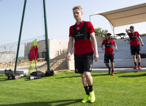 Gary Mackay-Steven heads out for training in Dubai.