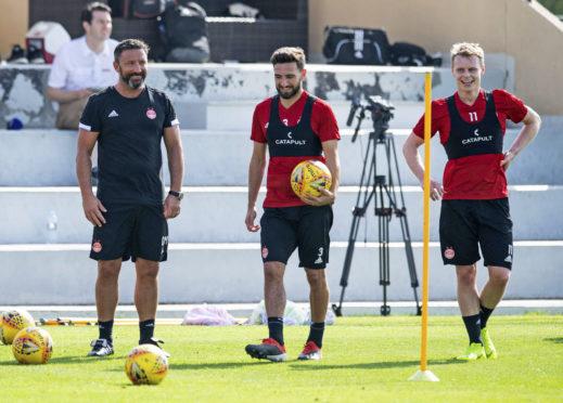 Derek McInnes with Graeme Shinnie and Gary Mackay-Steven in Dubai.