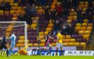 Ross County's Brian Graham wheels away after his second goal