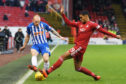 Aberdeen's Max Lowe challenges Chris Burke