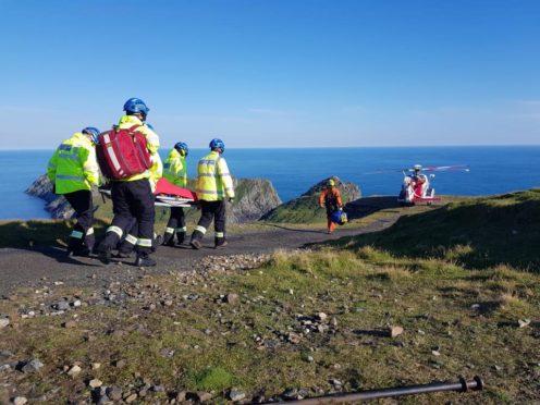 Coastguards abseiled down the sea cliffs of St Kilda.