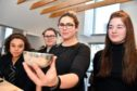 Silversmith Megan Falconer shows a hammered silver bowl to Banff Academy pupils (L-R) Ayesha Argo, Claire Campbell and Alana Cameron.