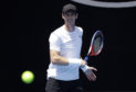 Britain's Andy Murray prepares to hit the ball during a practice session ahead of the Australian Open.