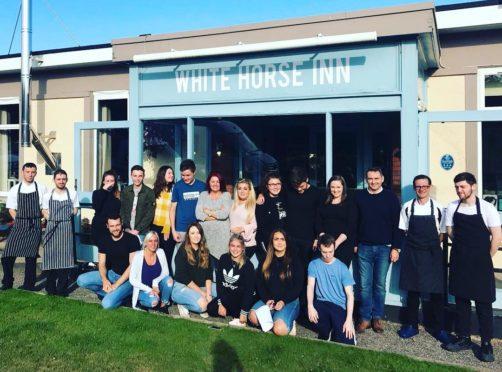 Staff outside the White Horse Inn