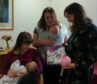 Left is breastfeeding mother Phoebe Johnson with her baby girl India, middle is community nurse Lindsay Michie and left is health visitor Louise Whyte